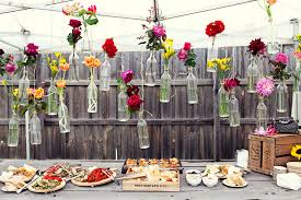 and creative garden wedding decoration ideas colorful flowers in hanging glass bottles for wedding