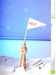 hand help flag sticking out of papers stock photography hand help flag sticking out of papers