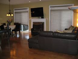 help decorating my living room. walls are a very pale yellow, my sectional is dark brown leather. and new looking for contemporary feel however with some elegance. can anyone help decorating living room