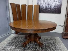 antiques by design indian head tables co oak paw foot dining table
