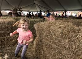 photos of the week digital loren lott 5 left runs through the hay maze followed by makenna nutter