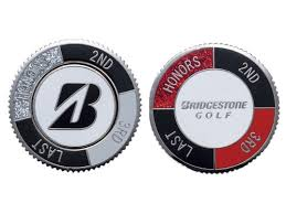 ball markers. bridgestone golf ball markers black/red