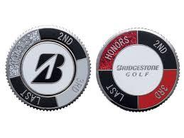 ball markers. bridgestone golf ball markers black/red