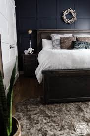 navy master bedroom with diy accent wall