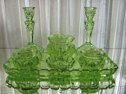 green depression glass collection on art deco green uranium glass dressing table set