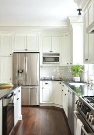white cabinets with bronze hardware off white shaker island cabinets are adorned with oil rubbed bronze