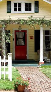 yellow house with red door home ideas yellow houses play houses and cycling