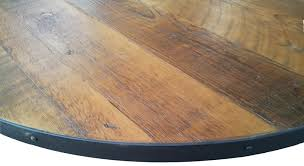 round wooden table with metal base designs