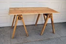 12 rustic inspired diy sawhorse tables and desks shelterness wood sawhorse table legs