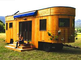 tiny house manufacturers. Brilliant Tiny The WOHNWAGON An Off The Grid Tiny House Built By Austrian Manufacturers  Wohnwagon Is Wrapped In A Rounded Larchclad Shell On Tiny House Manufacturers I