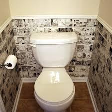 I have seen old newspapers and sheet music used as wallpaper for walls, but  I love this idea for using Far Side calendars as wallpaper.