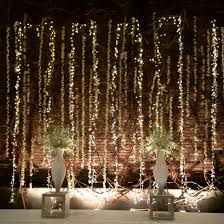 How To Hang Rope Lights On Brick Dress Up A Brick Wall With Flowers Wedding Wall Light