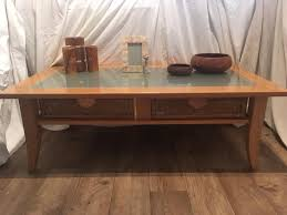 solid wood beech and frosted glass coffee table with wicker basket drawers