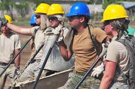 u s department of defense photo essay  u s and an service members watch troops pour and smooth slurry for of a new school
