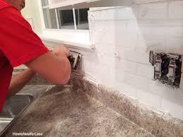 grout white subway tile backsplash