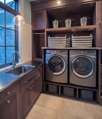 ... in this layout - maybe those baskets under the appliances but they look  a bit small for that purpose since a laundry room this size is most likely  in a ...