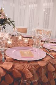 This clean, elegant wedding theme was all about romance. Exquisite gold  Peacock Tablecloths exuded