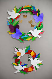 a diy peace and love paper wreath use watercolor washes on our free templates to