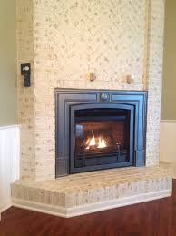 valor 534iln horizon log fire gas direct vent fireplace or insert installed with fenderfire door front red brick liner and vintage iron cast surround