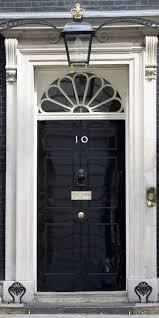black door 10 downing street london real door hardware painted black to blend with door gold s in center