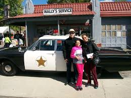 mayberry squad car tours striking a pose after riding the replica squad car tour