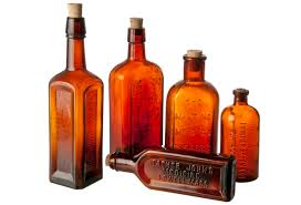 set of five vintage amber apothecary bottles