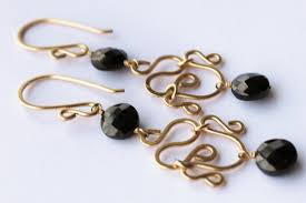 black and gold chandelier earrings with black spinel and 14 karat handmade filigree gold