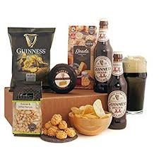 guinness gifts this por beer gift includes 2 bottles of the magic of guinness with savoury snacks and cheese new revised version amazon co uk