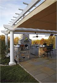 outdoor kitchen design and decorating ideas using light grey stone outdoor kitchen fireplace