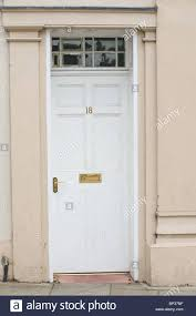 white front door with glass. White Front Door Meaning With Leaded Glass Ideas Stock Photo Painted Wooden Paneled No 18 Brass Handle N