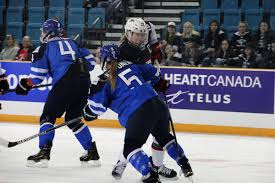 photo essay meg linehan live from usa world hockey  anna kilponen uses her body to block meghan duggan on the rush after the game