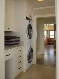Traditional beige floor laundry room idea in San Francisco with a stacked  washer/dryer