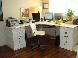 white office furniture ideas using offset corner shaped white solid wood desk with some drawers and black metal handling also white office swivel chair