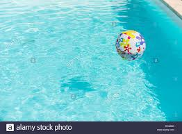 Contemporary Pool Water With Beach Ball Colorful Floating On Of Swimming In Design