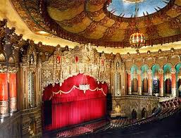 a giant four manual wurlitzer organ one of only five of its type ever built filled he hall with from its 36 ranks and 2 700 pipes