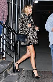 Small Picture Taylor Swift is ALL legs in mini skirt and leopard print coat for