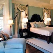 traditional blue bedroom ideas. Serene Blue Bedroom With Dark Wood Bed Traditional Ideas