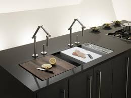 classy trough sink for kitchen ideas with unique faucet and glossy black countertops and cabinets plus