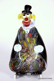 a novelty murano glass clown ashtray with a cased