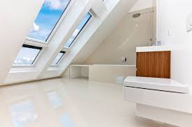 white bathroom designs. an all white bathroom with a slanted roof plenty of windows. the natural wood designs