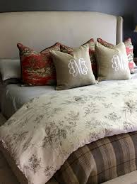 i knew i wanted a layered look and feel so rather than look for a new bedding set i started with a few things i already had toile pillows in an