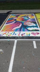 the seniors at my high school get to paint their parking spaces as a fundraiser we have some great talent that i wanted to share
