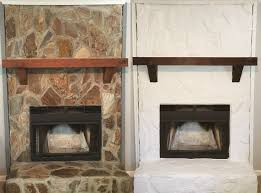 before and after painted rock fireplace i used a white masonry paint and stained the