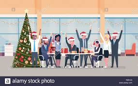 Business Team Raised Hands In Modern Office Decorated Fir Tree Happy