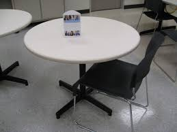 36 round white laminate table by steelcase