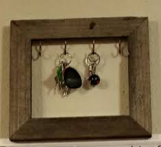 Homemade key holder, made out of an old picture frame and hooks from home  depot