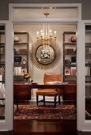a bold distinctive chandelier can make an eclectic home office feel unified rather than cluttered