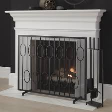 iron fireplace screen. Updating A Vintage Staircase Design, This Handcrafted Iron Fireplace Screen Adds Modern, Graphic Touch To The Room.