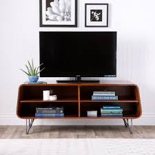 Keep your gadgets, DVD player and cable box safely tucked away with this  retro media center. The rounded rectangle provides four shelves for all of  your ...
