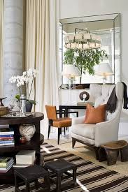 mid-century-living-area-with-striped-rug-also-frameless-mirror ...